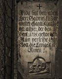 Antique gravestone on a church exterior wall Royalty Free Stock Image