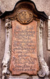 Antique gravestone on a church exterior wall Stock Photography