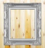 Antique gray frame on  wooden wall Stock Photos