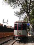 Antique gray and red trolley in Barranco, Lima. Lima, Peru. October 1, 2016. Vertical view of an antique gray and red trolley belonging to the Museum of Royalty Free Stock Images
