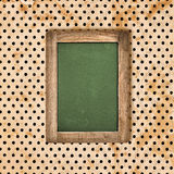 Antique green chalkboard over vintage polka dot background Stock Photography