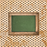 Antique green chalkboard over vintage polka Stock Photography
