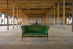 Antique Green Couch in old building Stock Photos