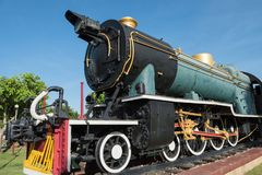 Antique green locomotive stream train. On railway track. old and classic period engine against blue sky Stock Images