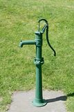 Antique green pump Stock Photo