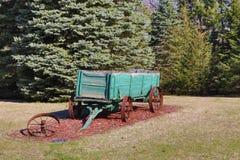 Antique Green Wagon as a Garden Decoration Stock Photos