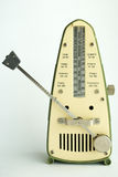 Antique Green and Yellow Metronome Royalty Free Stock Photos