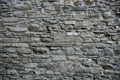 Antique grunge old gray stone wall masonry Stock Photos