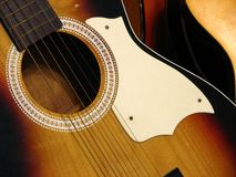 Antique guitar. Antique sunburst acoustic guitar close up Royalty Free Stock Images
