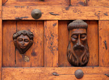 Antique hand carved wooden door. Antique hand carved heavy wooden door Royalty Free Stock Images