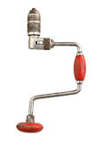Antique hand drill with red handle Royalty Free Stock Photos