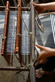 Antique hand loom. Closeup view and details of and antique hand-operated loom Royalty Free Stock Photography
