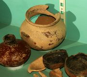 Antique hand made clay pots and bowls. In the vellore fort museum at vellore, tamilnadu, india Royalty Free Stock Photo