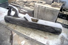 Antique hand plane. A large antique plane used to finish or plane the surface of wood Stock Photo