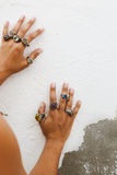 Antique handcrafted Turkish jewelry. Girl wearing antique handcrafted Turkish rings with grunge patterns and precious stones Stock Images