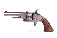 Antique Handgun. A photo of an antique firearm isolated on a white background. This style handgun was manufactured around 1870 Royalty Free Stock Image