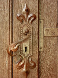 Antique handle. Old door locking system. Door wood with deep texture Stock Image