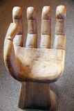 Antique handmade wooden arm-chair in the shape of a human hand Royalty Free Stock Image