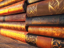 Antique hardback books. Outside in golden sunset colors stock photography
