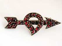 Antique heart and arrow brooch. Set with garnets royalty free stock photo