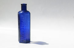Cobalt Blue Bottle. An antique hexagonal chemist's bottle with the words Not To Be Taken embossed on one side Royalty Free Stock Photography