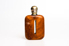 Antique hip flask. Small colorful plastic glasses isolated on white Stock Image