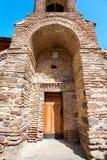 Antique historical stone enter arcade in David Gareji monastery. Antique historical wooden door in stone enter arcade in David Gareji monastery complex on Royalty Free Stock Photo