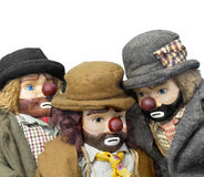 Antique hobo dolls isolated. Close-up of three antique hobo dolls. Isolated on white royalty free stock photo