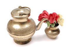 Antique holy copper vessel and flowers Stock Photos