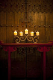 Antique homewares setting with burning candles Stock Images