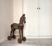 Antique horse toy with wheel. In the living room Royalty Free Stock Photo