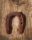 Antique horseshoe luck symbol rusted on vintage wood Royalty Free Stock Photo