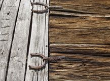 Antique horseshoes as barn door hinges Royalty Free Stock Photo