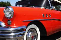 Antique Hot Rod. An old antique 1950 buick hot rod.  Shiny orange, with lots of chrome.  Great collectors car Stock Photo