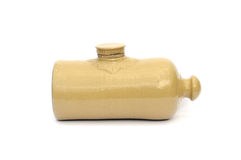 Antique hot water bottle. An earthenware hot water bottle probably dating from about 1920 stock photo