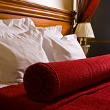 Antique hotel bed. An antique bed in a luxurious hotel room Stock Images