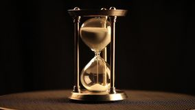 Antique hourglass. Beginning of a cycle stock footage