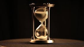 Antique hourglass. Beginning of a cycle (rapid stock footage