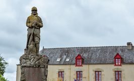 Antique house of the French Brittany and military statue royalty free stock images