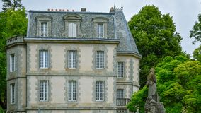Antique house of the French Brittany and military statue royalty free stock photography