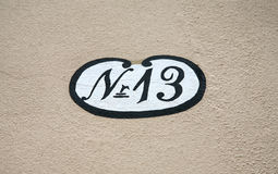 Antique house number 13 Stock Photo