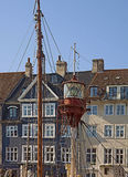 Antique house and old ship moored in Nyhavn, Copenhagen l. View of ancient house facade in Nyhavn with the mast of a ship moored. Nyhavn channel, famous Royalty Free Stock Image