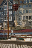 Antique house and old ship moored in Nyhavn, famous Copenhagen l. View of ancient house facade in Nyhavn with the mast of an ship moored. Nyhavn channel, famous Stock Images