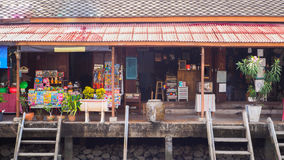 Antique house shop along the canal at Ampawa royalty free stock image