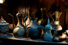 Antique household items. Antique household objects on old wood shelf at Sharjah heritage souq area Royalty Free Stock Image