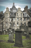 Antique houses and cemetery in Edinburgh city downtown. Scotland Stock Photography