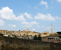 Antique houses and Mangia tower. Siena, Italy Royalty Free Stock Photos