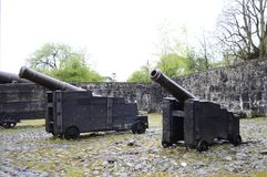Huge cannons in Bunratty Castle. Antique huge cannons defending Bunratty Castle in Ireland Stock Image