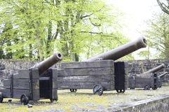 Huge cannons in Bunratty Castle. Antique huge cannons defending Bunratty Castle in Ireland Royalty Free Stock Images