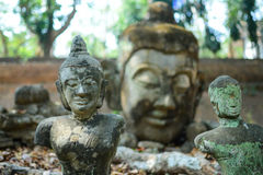 Antique image of Buddha focus on front object Royalty Free Stock Photography
